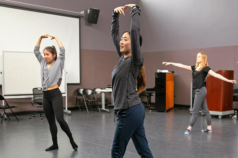 3 students rehearse ballet in a studio