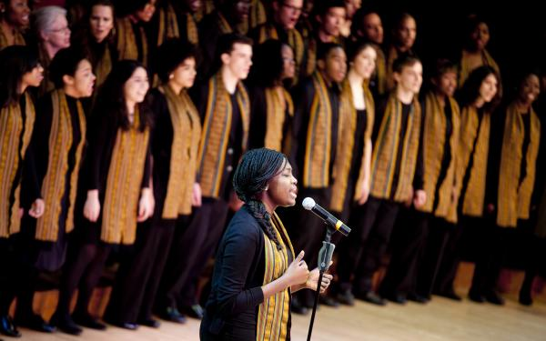Harvard Kuumba singers performing on stage