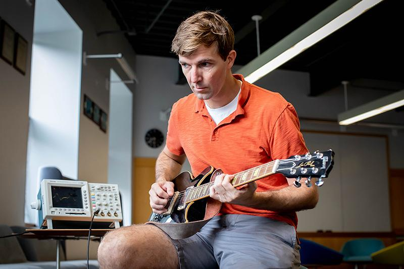 Robert Wood takes his guitar for a spin in preparation for his new course which combines engineering with music.