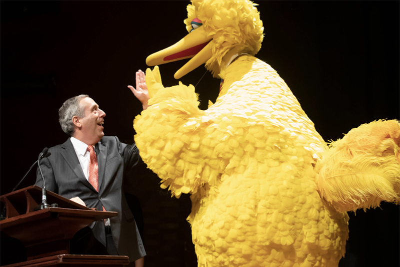 President Larry Bacow and Big Bird