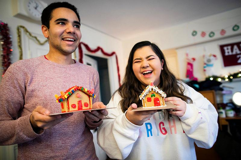 Lena Lofgren '23 and Kyle Felter '23 show off their completed gingerbread houses