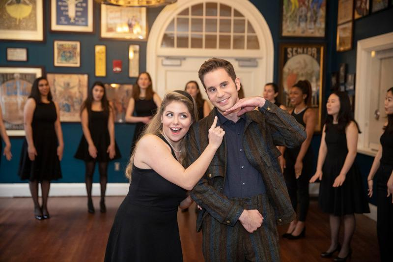 Ben Platt (right) is entertained by Sydney McDonald '21 and the Radcliffe Pitches.