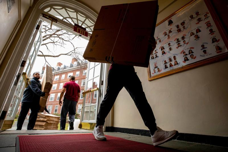 Packing boxes move in as students pack up to move out of Eliot House.