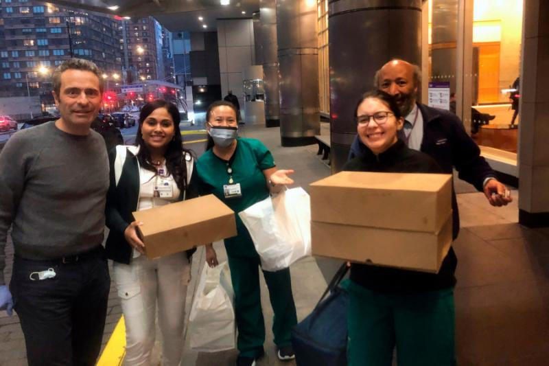Luca Di Pietro (left) makes the first meal delivery from Feed the Frontlines NYC to the NYU Langone Medical Center's Emergency Department.