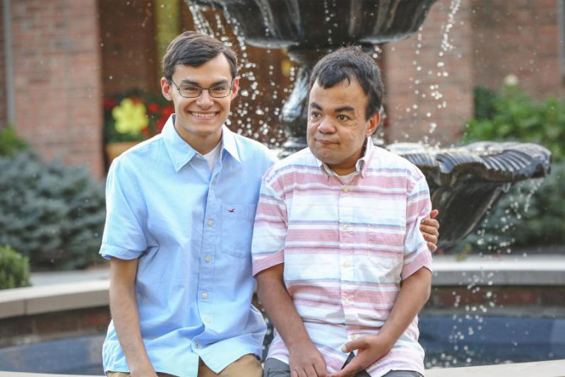 Harvard graduate Nathan Grant and his twin brother, Nik, who has Hunter syndrome.