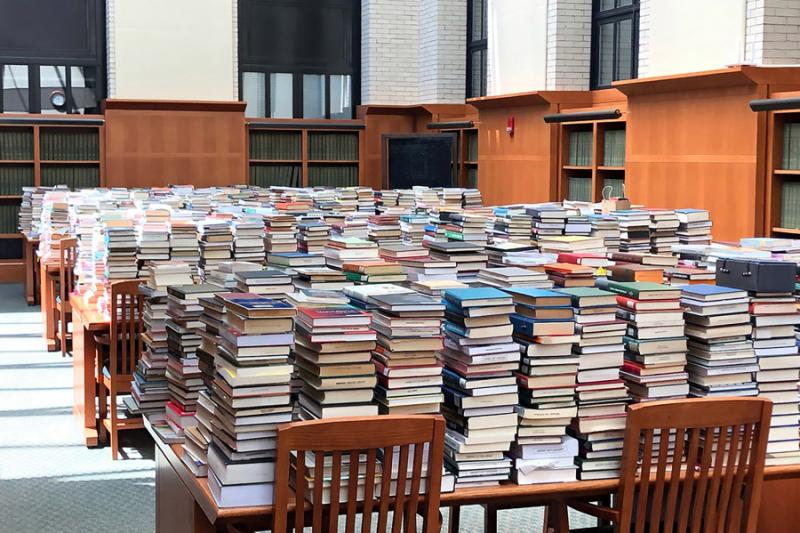Returns were temporarily stored in the West Stacks Reading Room in Widener Library as they awaited processing by library staff.