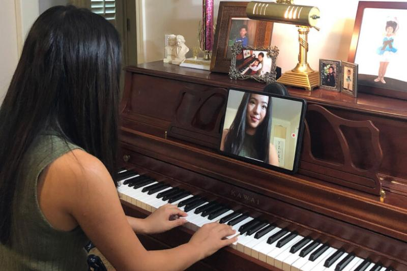 Lucy Tu recording a piano piece for her students.
