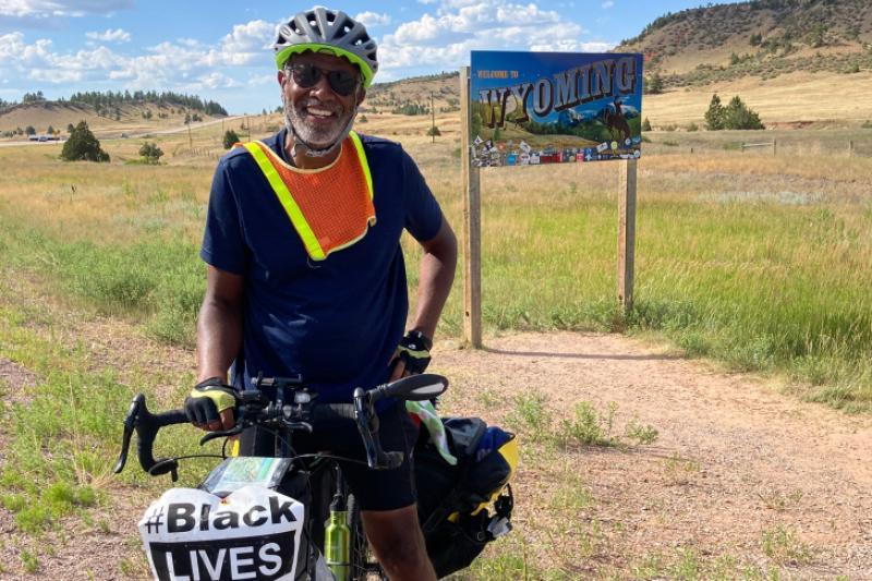 Professor Scott Edwards enters Wyoming on his bike.