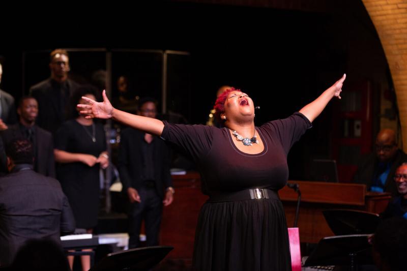 "De-Rance Blaylock, a former teacher of Michael Brown, leads the ""Antigone in Ferguson"" choir."