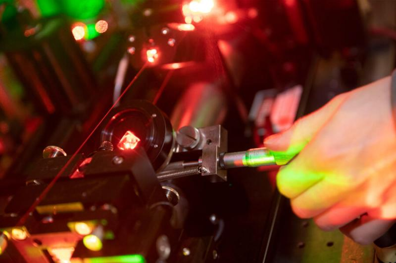 Working with lasers in the Doyle Lab.