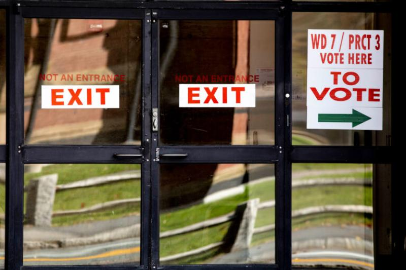 At the polls, there are signs pointing in the direction of where individuals should go to cast their ballots.