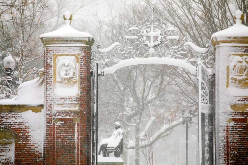 Harvard Yard's Johnston Gate is pictured during a December snowstorm.