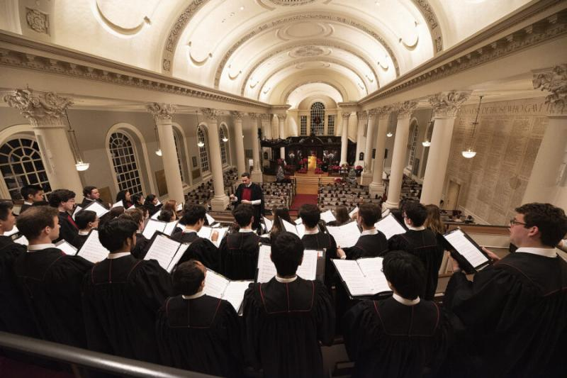 The choir performs at Harvard Memorial Church during a prior year's service.