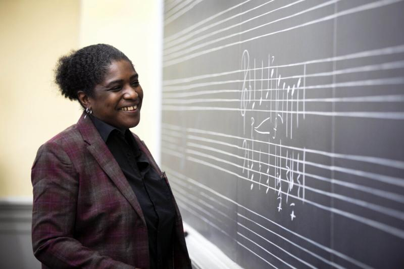 Yvette J. Jackson, the Assistant Professor, Department of Music, stands in her classroom.