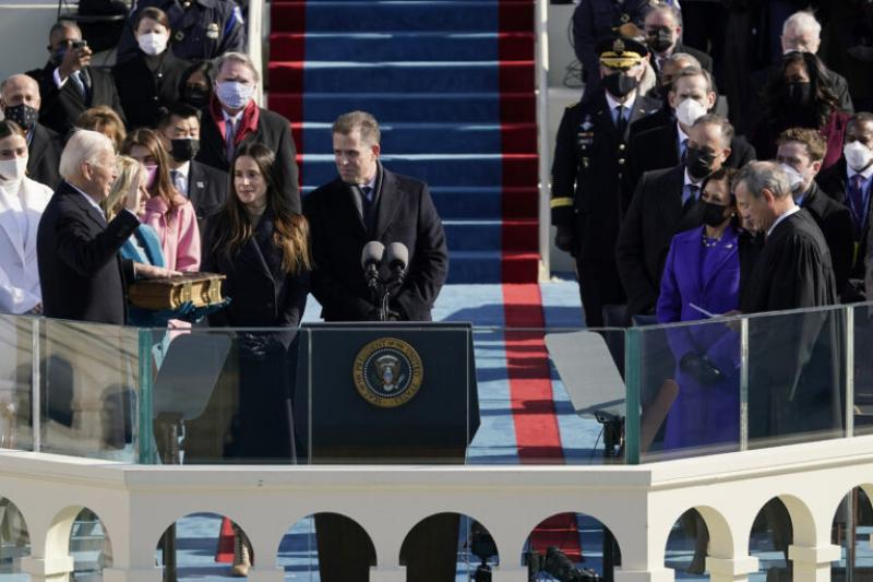 Joe Biden is sworn in as the 46th president of the United States by Chief Justice John Roberts (far right).