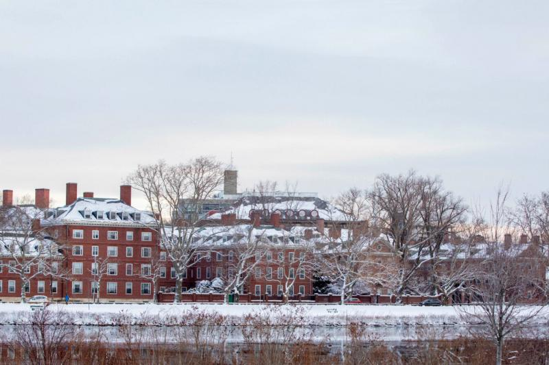 The towers of Eliot and Lowell Houses are pictured along the Charles River after a 2019 winter storm.