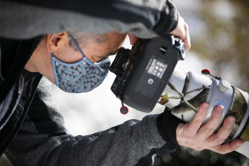 Gonzalo Giribet, professor of organismic and evolutionary biology, has been going out in the early morning to take photographs of birds since the pandemic started. He is pictured in Mount Auburn Cemetery.
