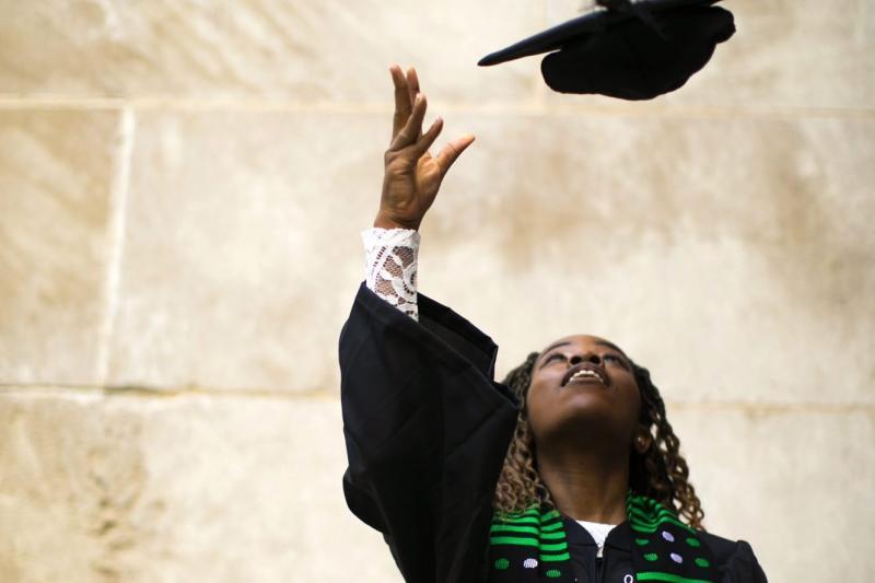 2021 graduate Nina Uzoigwe throws her cap.