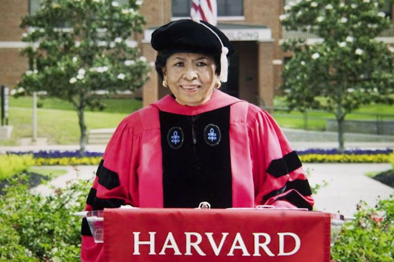 Ruth Simmons in  Harvard Graduation Regalia  at a podium during her Graduation speech to the class of 2021