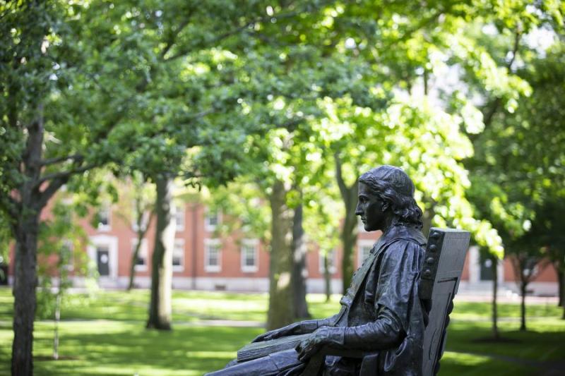 John Harvard watching over Harvard yard