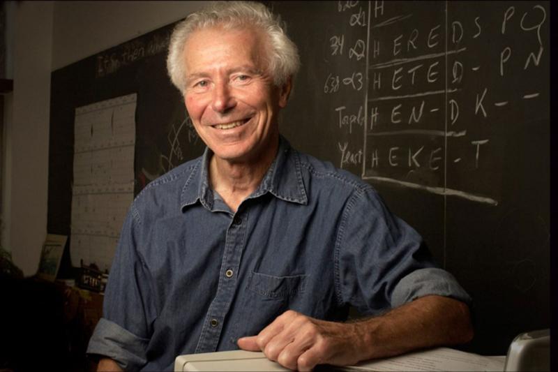 Guido Guidotti in front of a chalk board