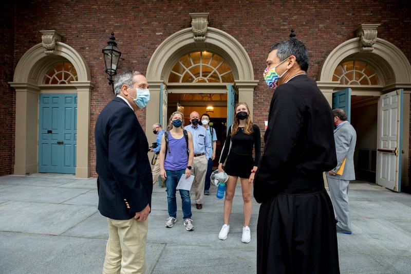 Harvard President Larry Bacow (left) and the Rev. Matthew Ichihashi Potts spoke following Morning Prayers at the Memorial Church.