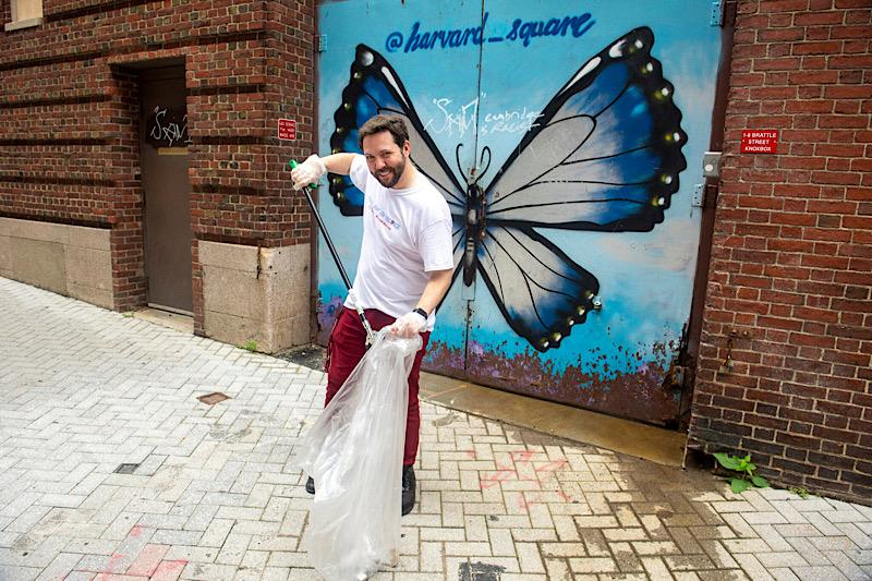 Team leader Kody Christiansen '23 cleans up Palmer Street behind the Coop in Harvard Square.