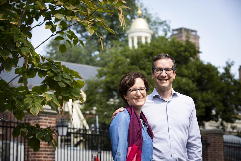 Nina Zipser and David Laibson stand in front of Lowell House
