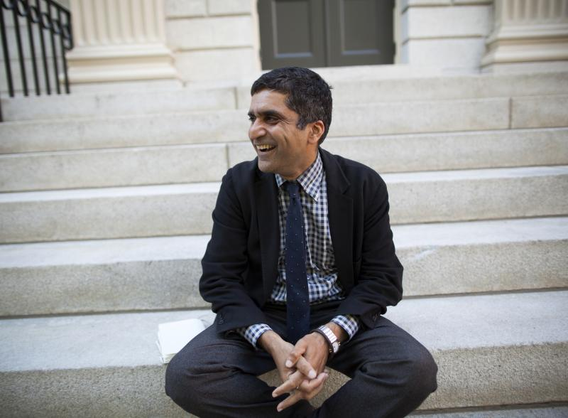 Danoff Dean of Harvard College, Rakesh Khurana, on the steps of University Hall