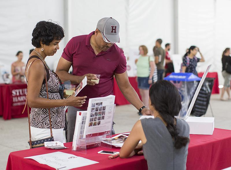 parents during the resources welcome fair on move in day at one of the tables
