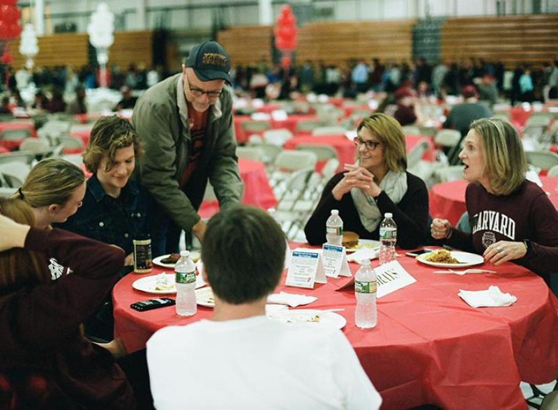 parents and familes at a table talking with the dean of students