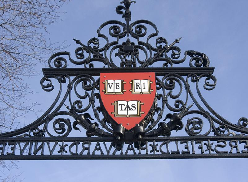 harvard veritas shield on gate