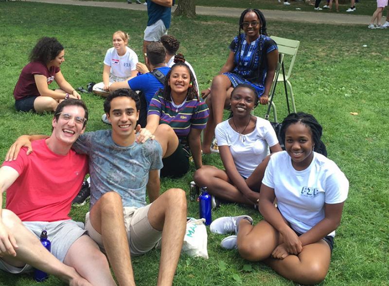 students sitting in Harvard Yard