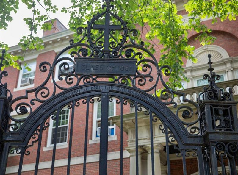 Phillips Brooks House behind the Class of 1881 gate.