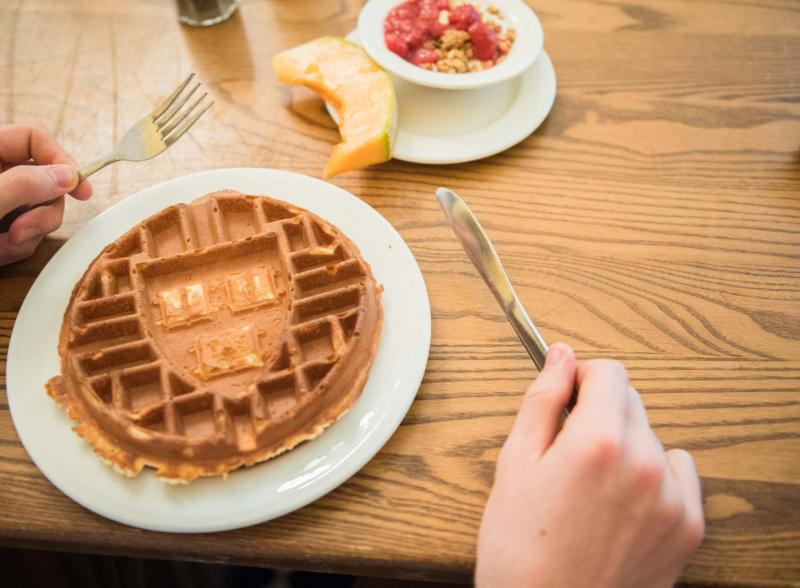 A waffle with an imprint of the Harvard shield on it