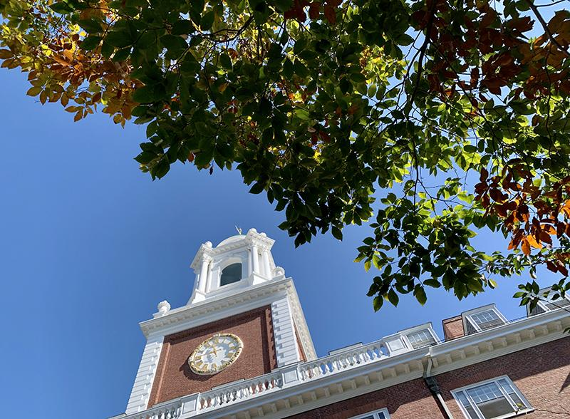 Looking up at the Lowell House clock tower.