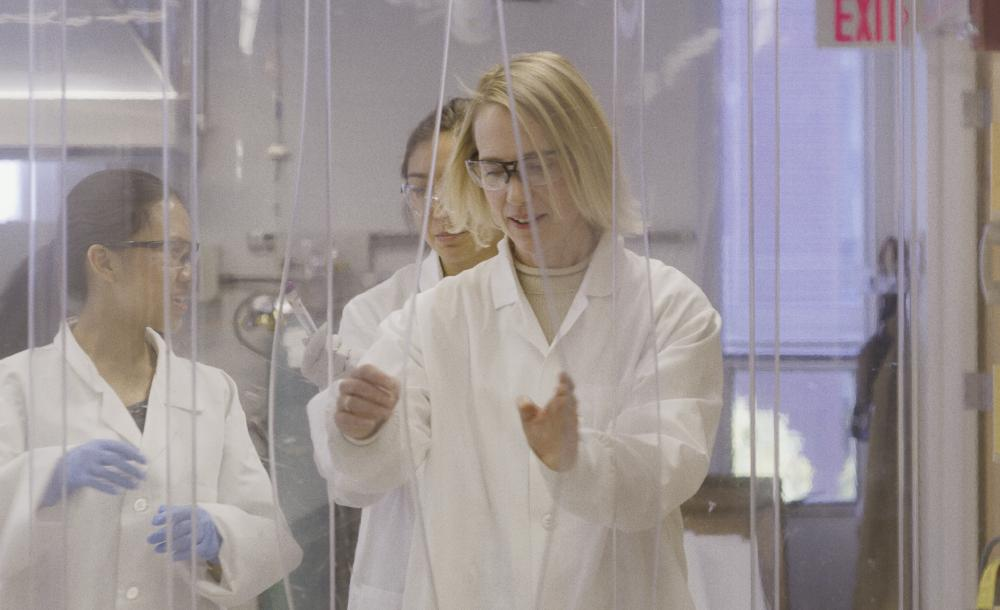 Professor in a science lab with students