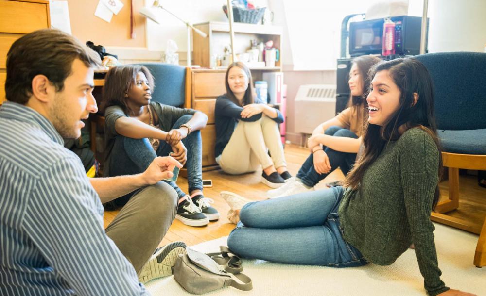 students in their dorm sitting around talking