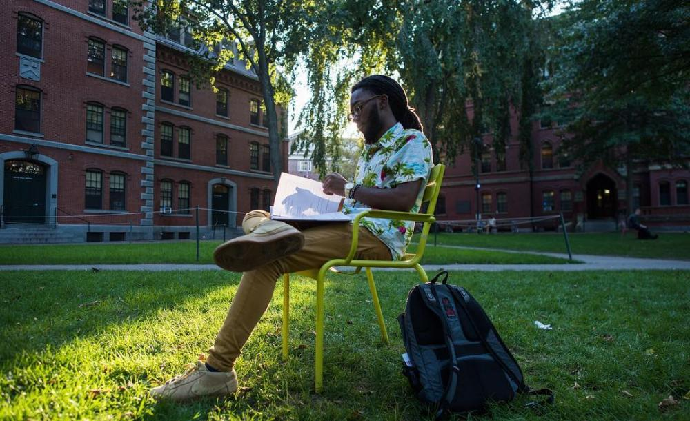 Student studying in Harvard Yard