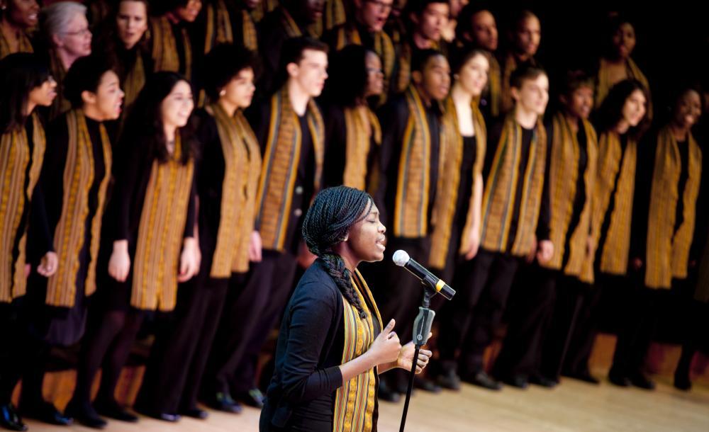 Harvard Kuumba singers performing on stage