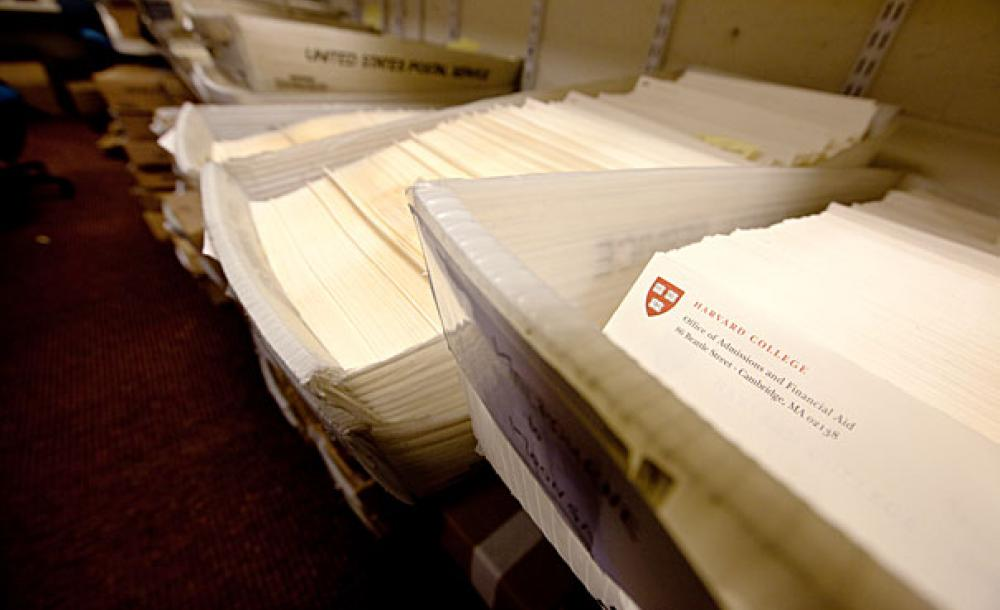 Dozens of admissions packets in mailing bins