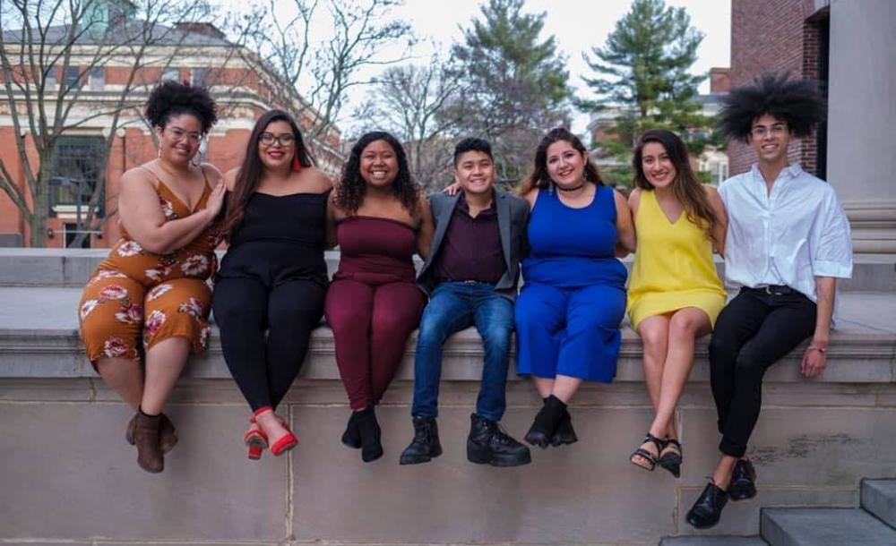 Maribel and friends sit on Widener Library's edge.