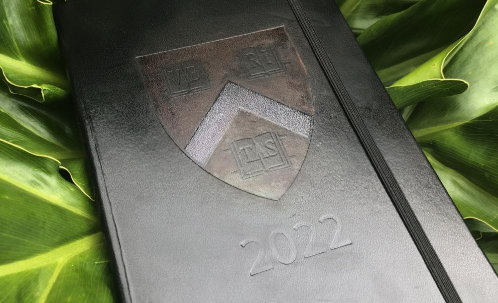 Black journal with Harvard logo and 2022 imprinted on the front