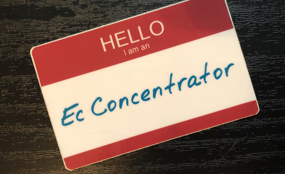 """Photo of sticker that reads """"Hello, I am an Ec Concentrator"""""""