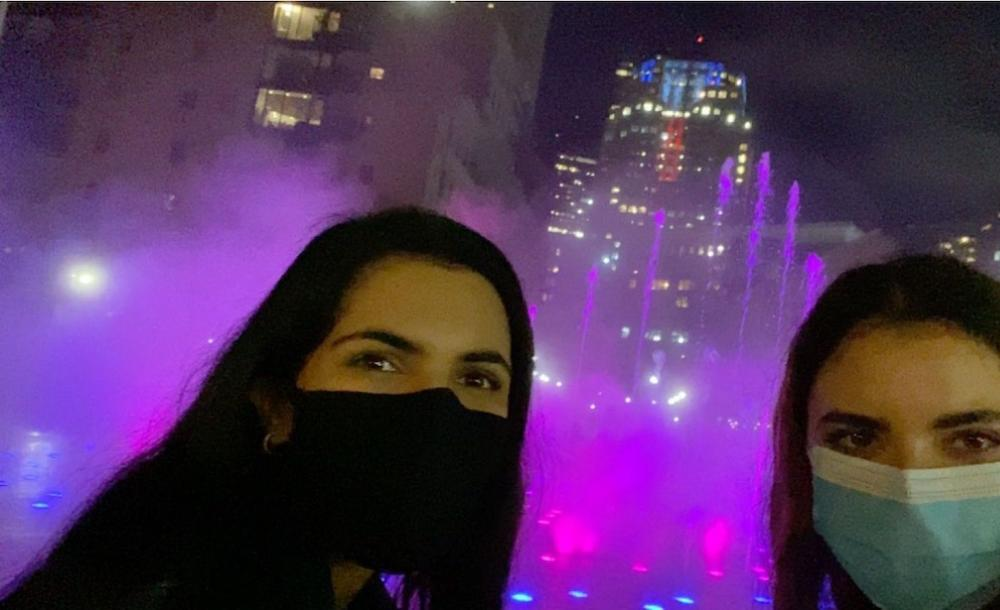 Image of my friend and I at a fountain in Boston