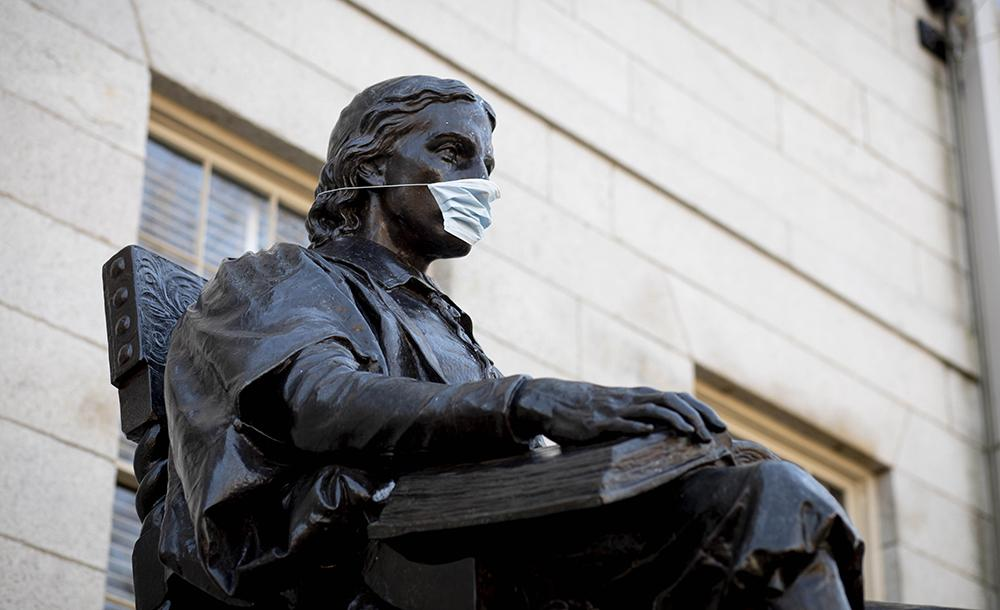 John Harvard Statue wearing a Mask