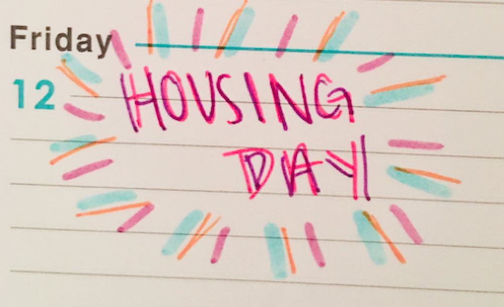 I wrote 'Housing Day' on my agenda's calendar.