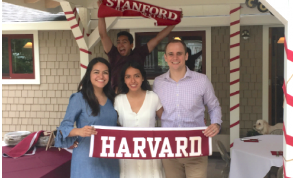 Students holding Harvard flag