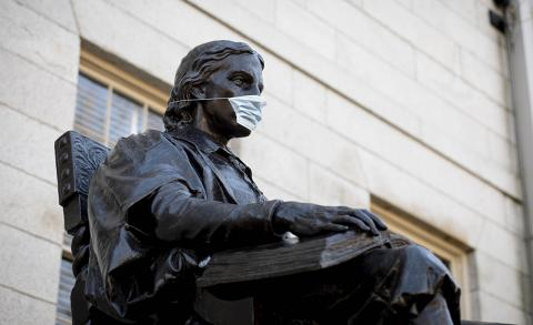 John Harvard Statue wearing a Mask
