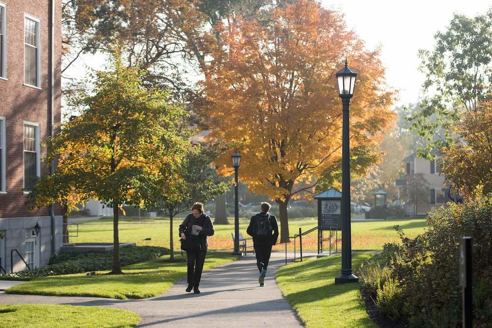students walking on campus in the fall